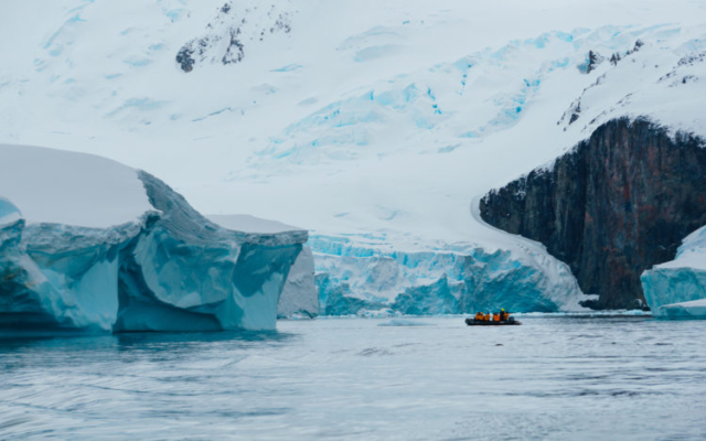 Zodiac cruising around icebergs in Antarctica