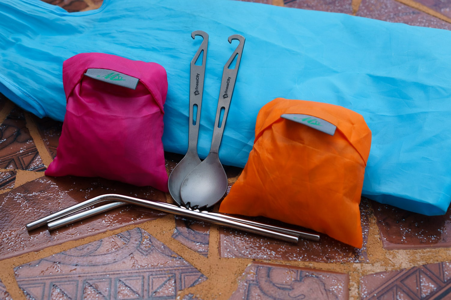 Packing reusable Cloth bags, titanium sporks, and straws helped us to reduce our plastic usage while travelling