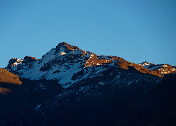 Sunrise on the opposite peaks of the Colca Canyon